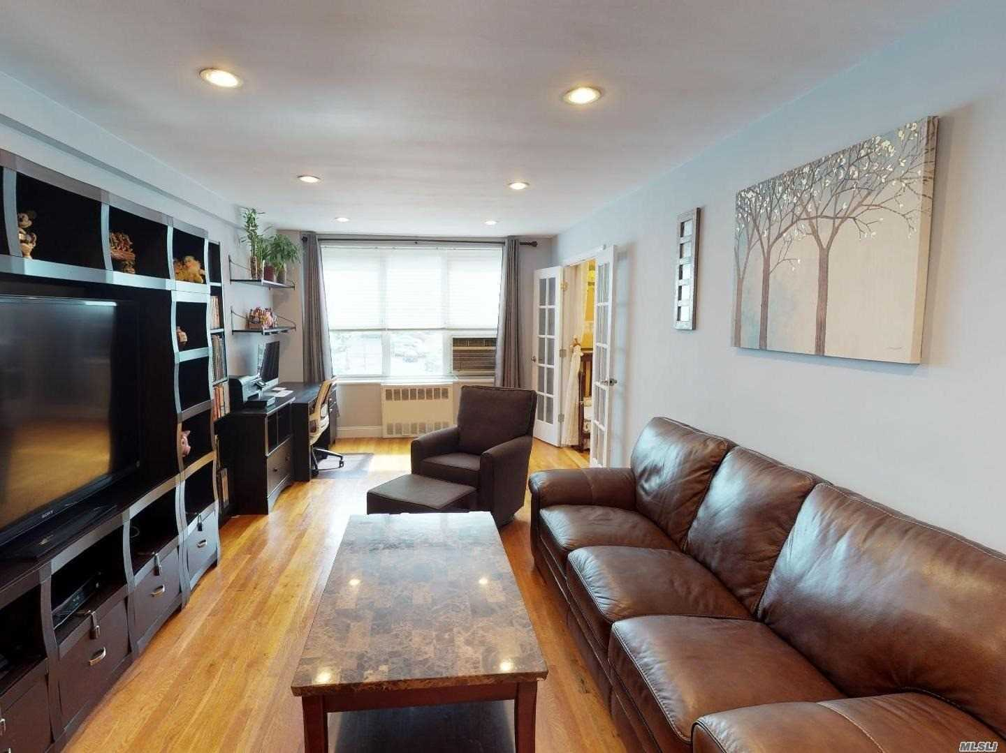 Photo of home for sale at 18-50 211Th St, Bayside NY
