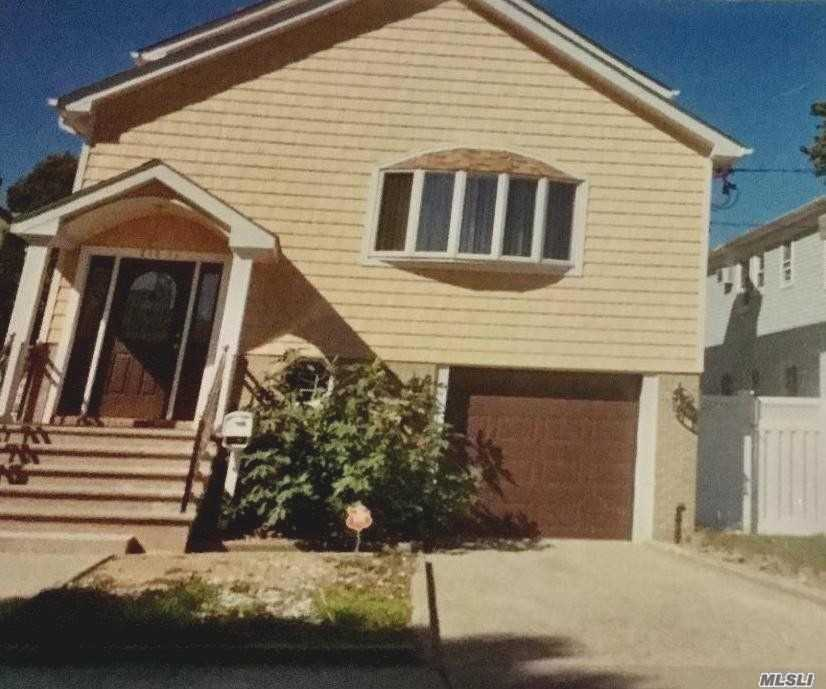 Photo of home for sale at 218-11 94 Th Dr, Queens Village N NY