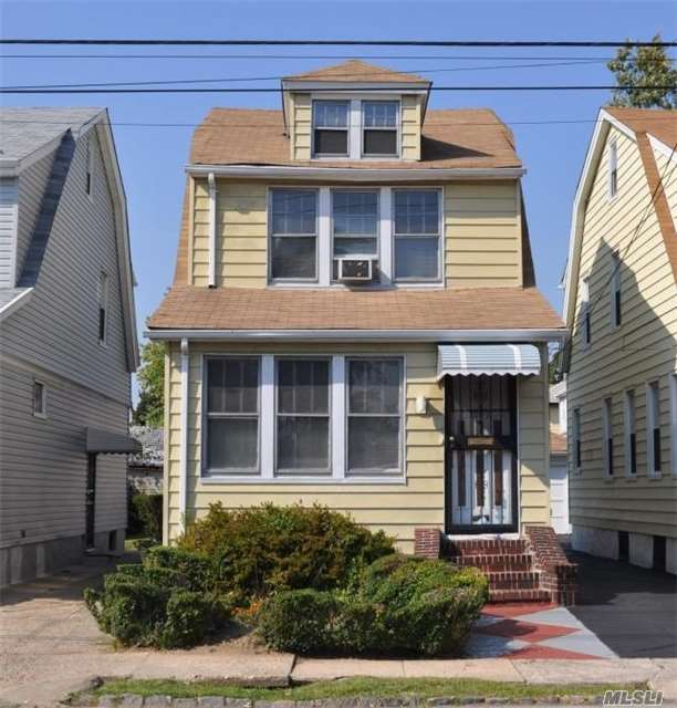 Photo of home for sale at 200-11 119th Ave, Jamaica NY