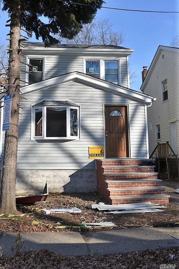 Photo of home for sale at 109-21 125th St, South Ozone Park NY