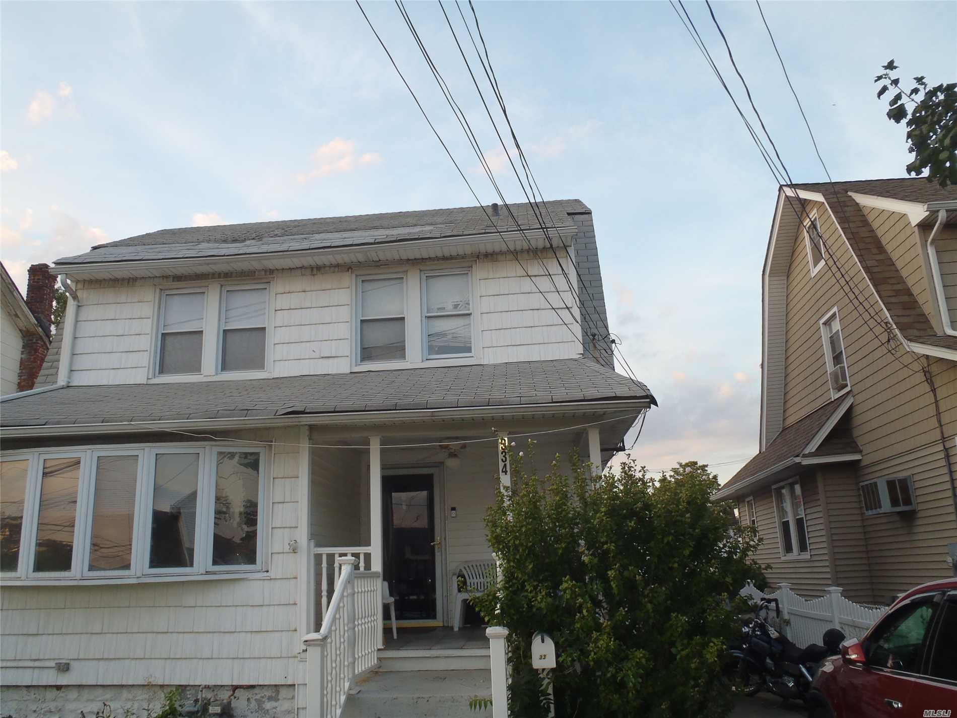 Photo of home for sale at 334 Riverside Ave, Oceanside NY