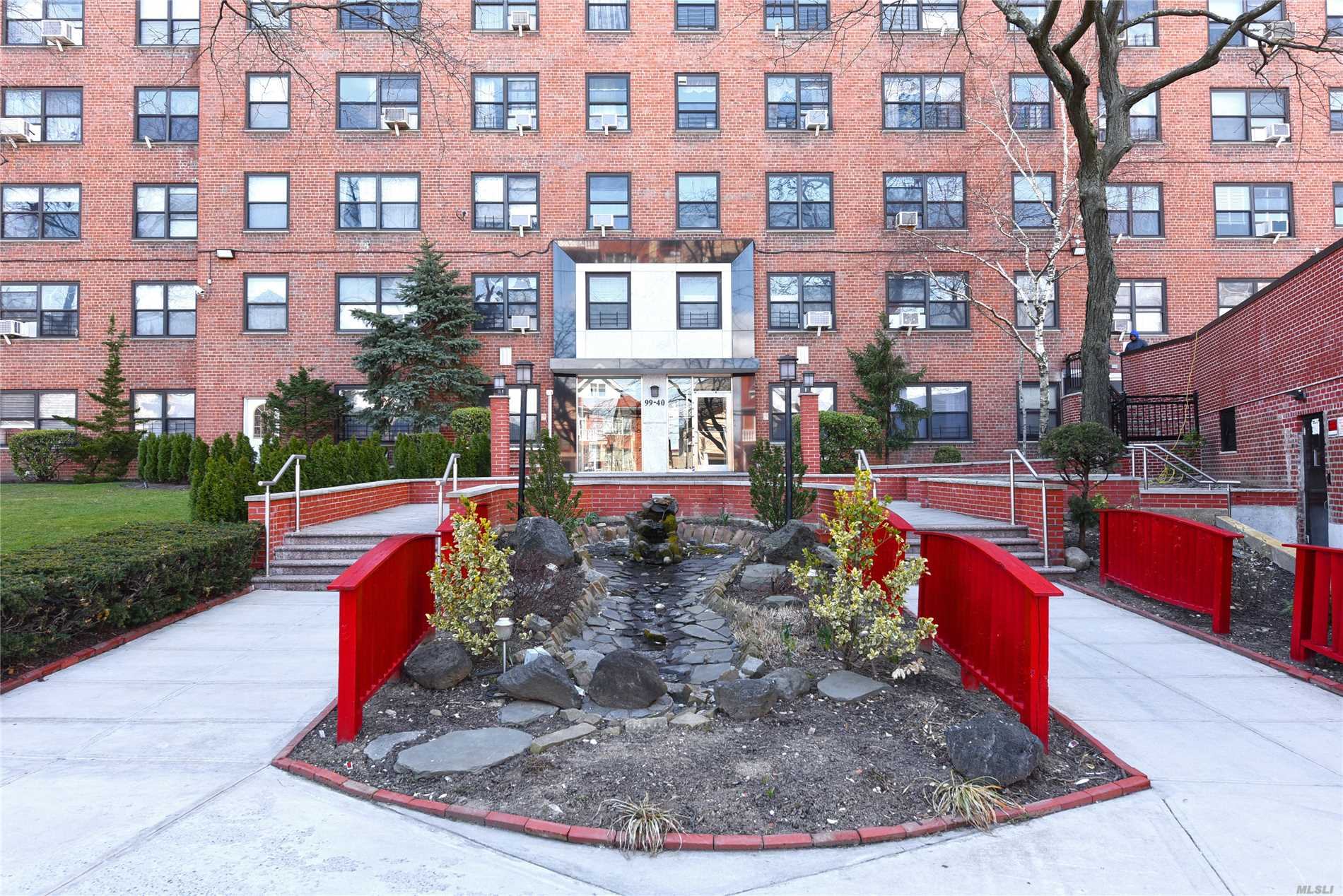 Photo of home for sale at 99-40 63 Rd, Rego Park NY