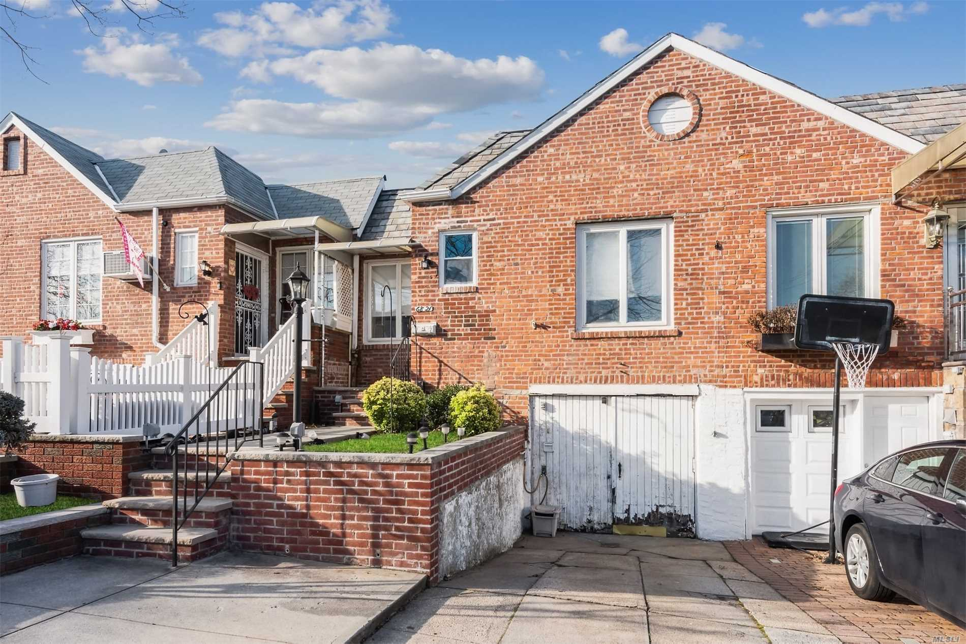 Photo of home for sale at 68-21 60th Rd, Maspeth NY