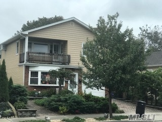 Photo of home for sale at 515 Market St E, Long Beach NY