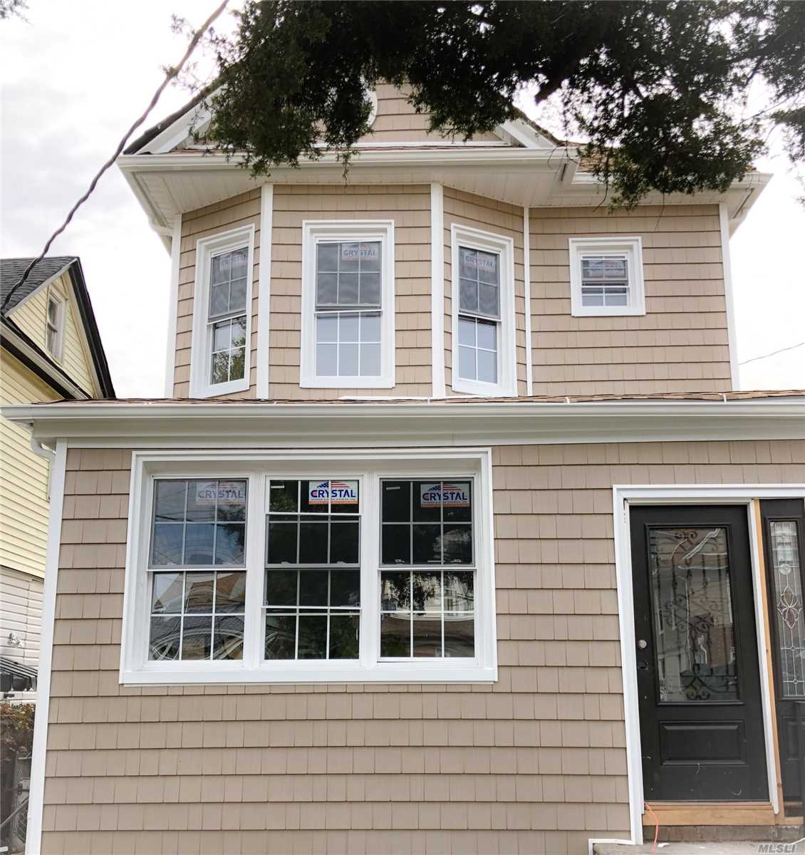 Photo of home for sale at 188-12 Ludlum Ave, Jamaica NY