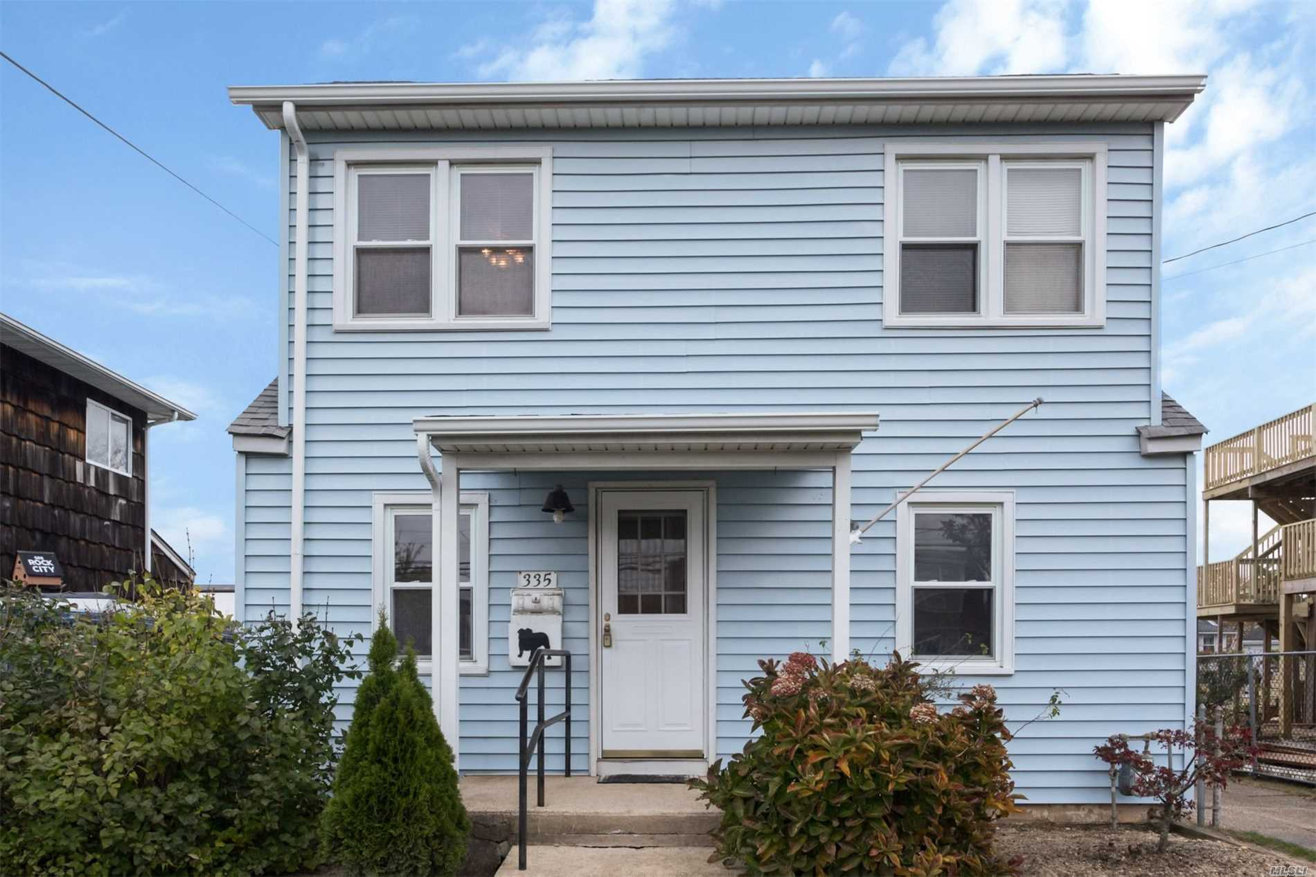 Photo of home for sale at 335 West Dr, Copiague NY