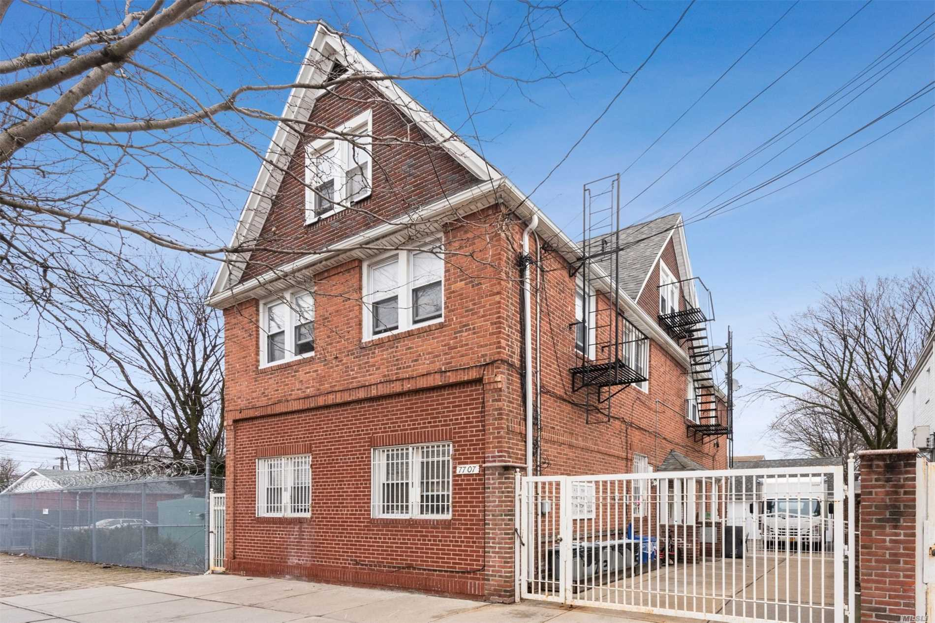 Photo of home for sale at 77-07 164th St, Flushing NY