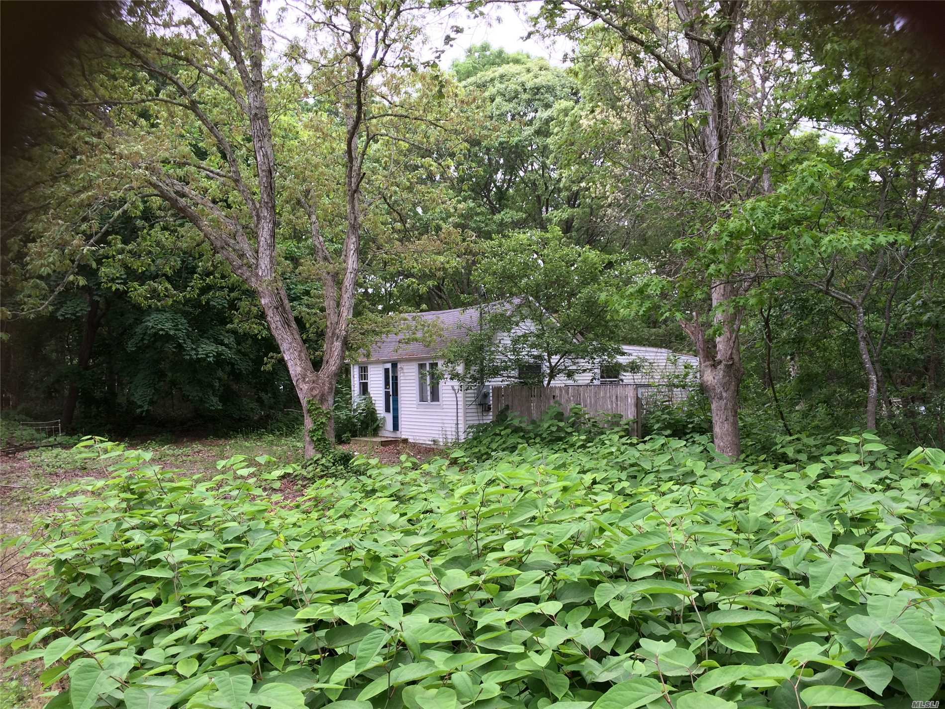 Photo of home for sale at 110 Wading River Rd, Center Moriches NY