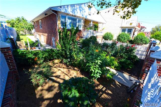 Photo of home for sale at 108-47 51st Avenue, Corona NY