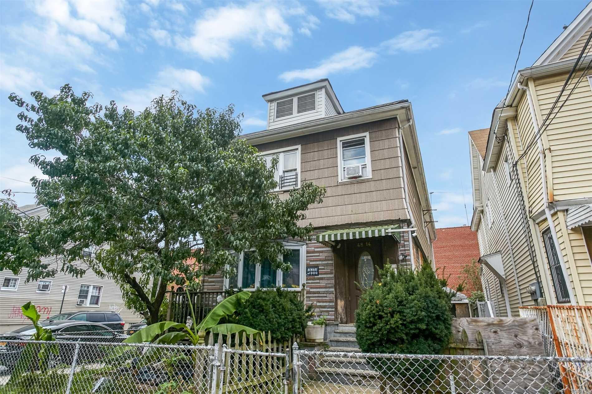 Photo of home for sale at 48-14 94 St, Elmhurst NY