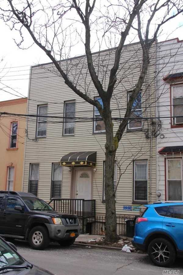 Photo of home for sale at 16-28 Summerfield St, Ridgewood NY