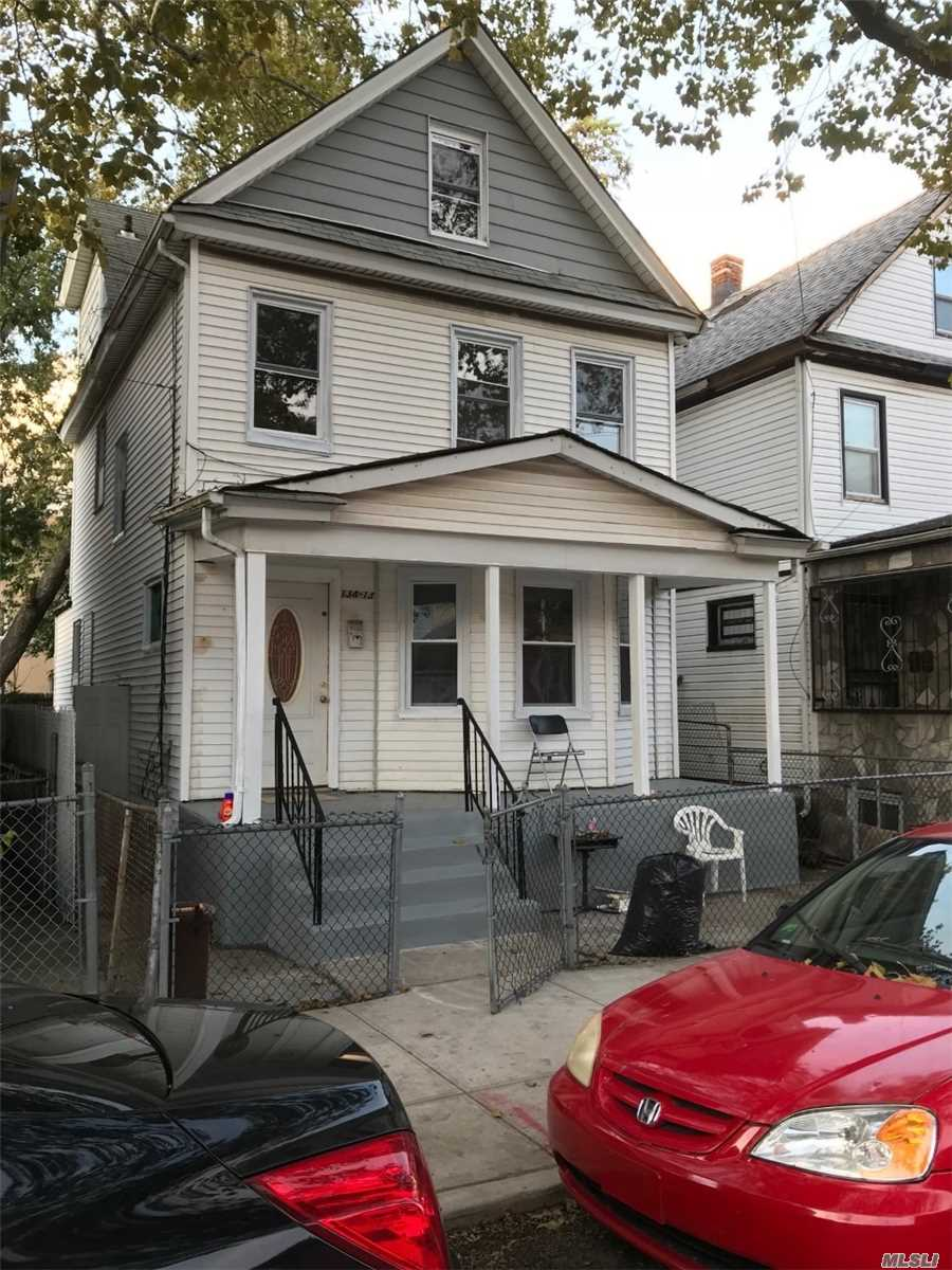 Photo of home for sale at 134-13 102nd Ave, Richmond Hill NY
