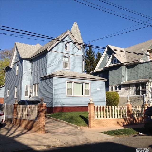 Photo of home for sale at 86-11 107th St, Richmond Hill NY