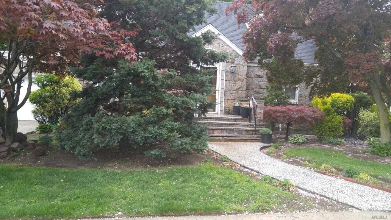 Photo of home for sale at 337 James Ct, West Hempstead NY
