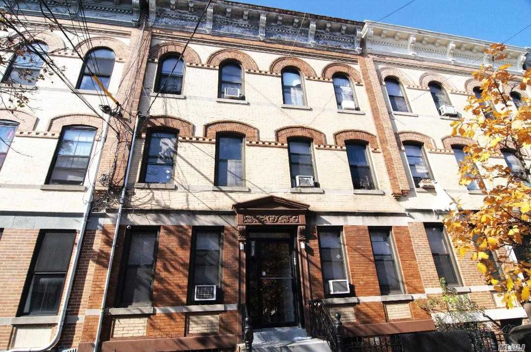 Photo of home for sale at 18-71 Madison St, Ridgewood NY