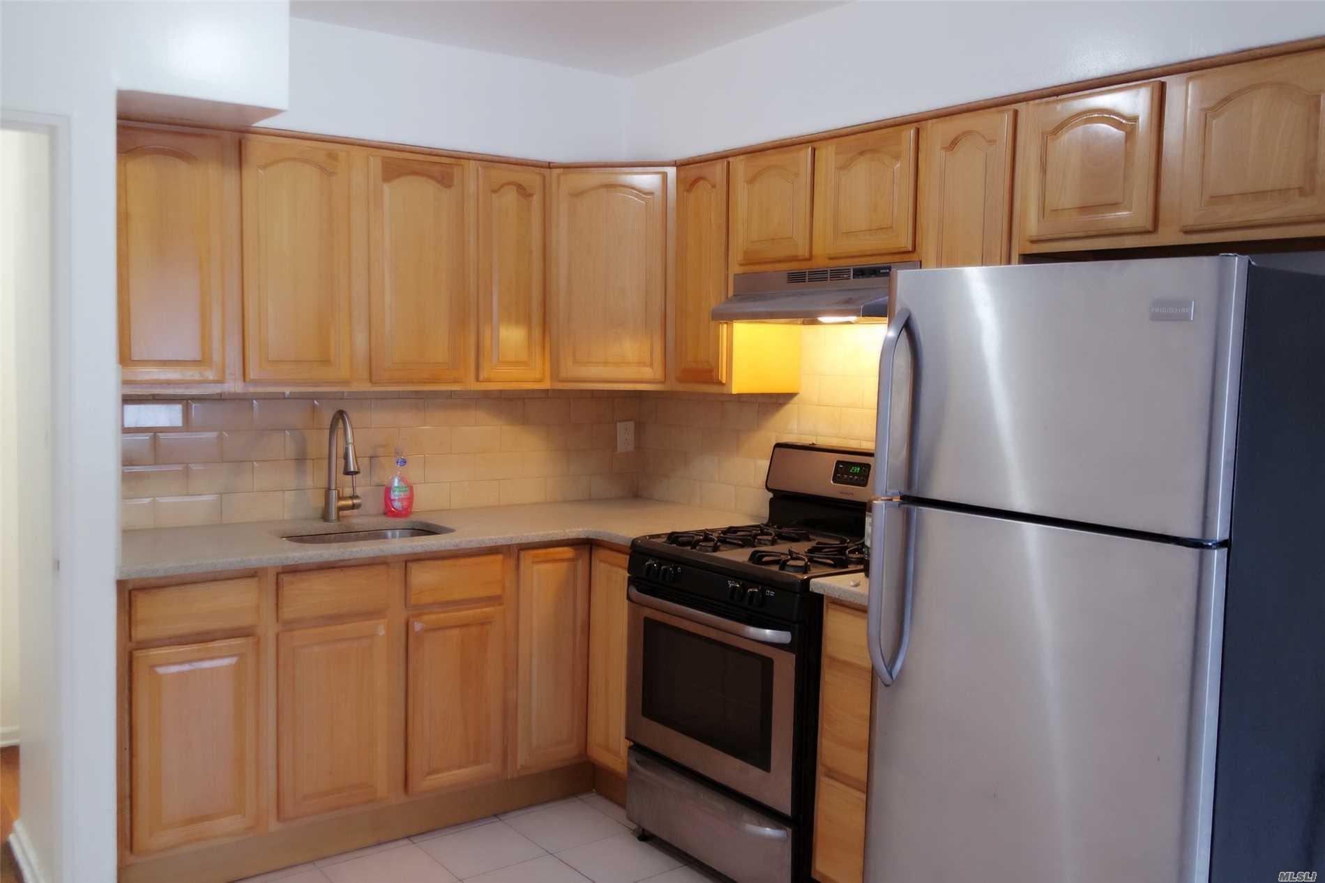 Photo of home for sale at 25-50 73rd St, Flushing NY