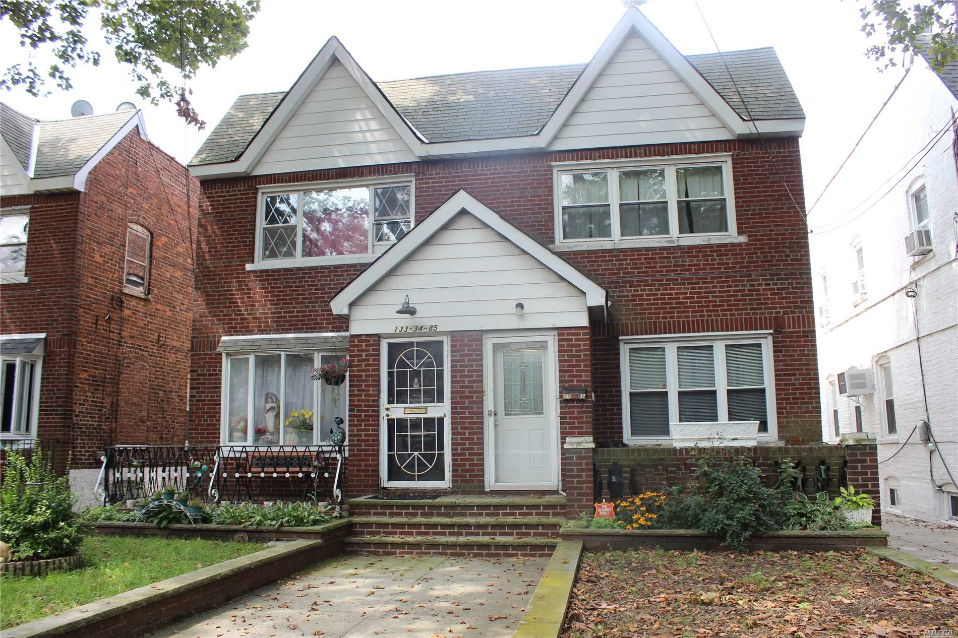 Photo of home for sale at 133-32 85 St N, Ozone Park NY