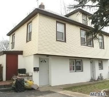 Photo of home for sale at 82 Fern Pl, Inwood NY