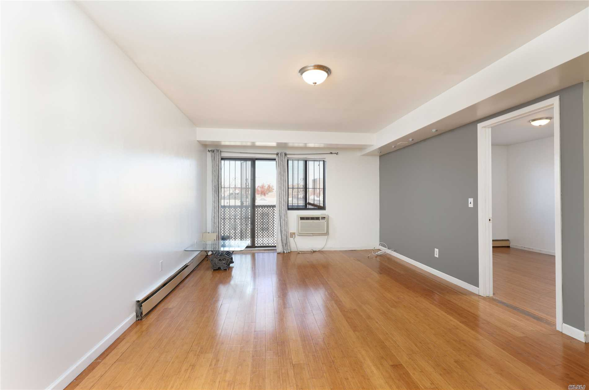 Photo of home for sale at 58-61 44th Ave, Woodside NY