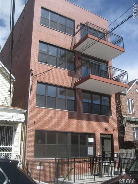 Photo of home for sale at 58-09 Seabury Street, Elmhurst NY