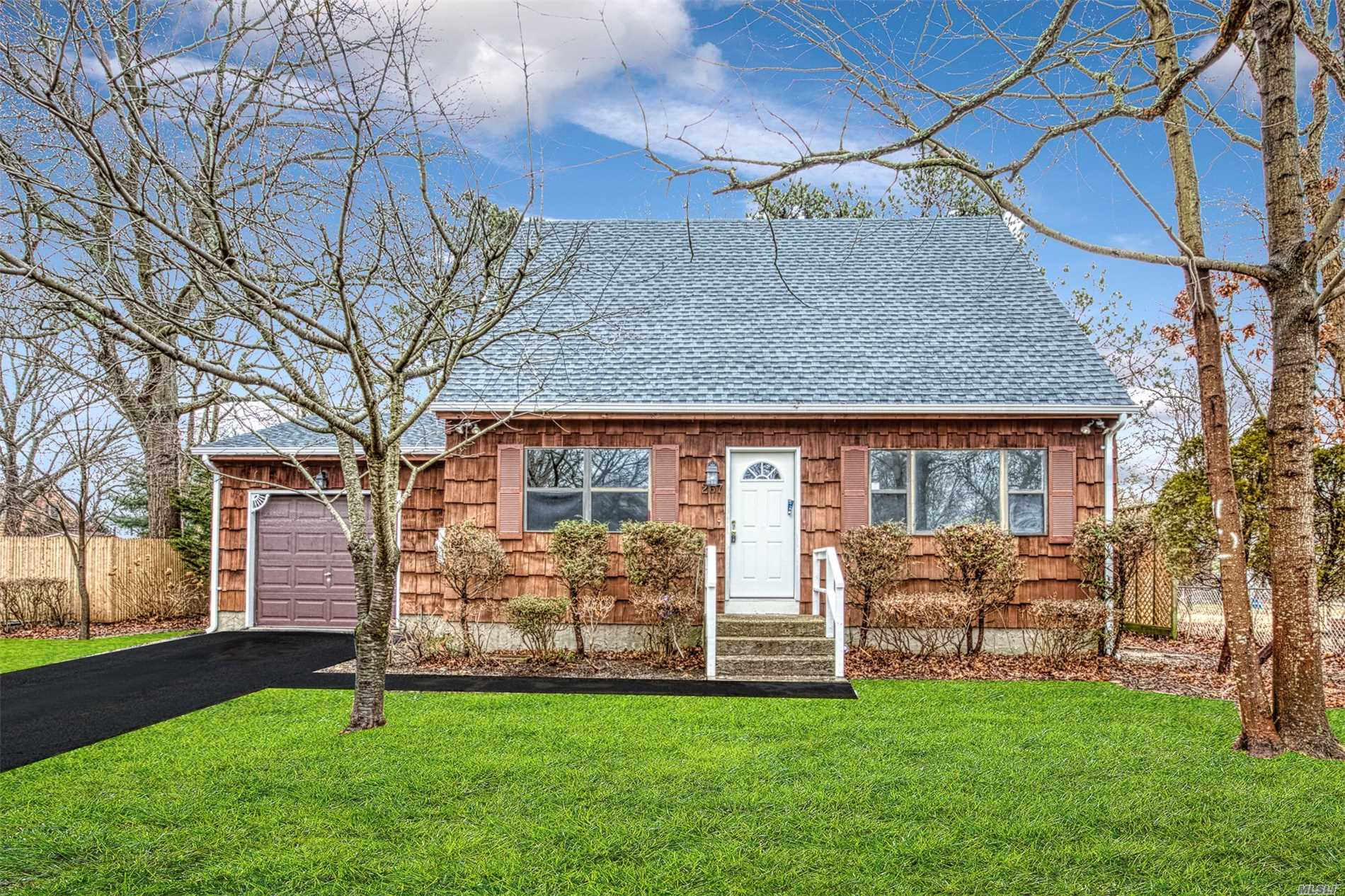 Photo of home for sale at 267 Titmus Dr N, Mastic NY