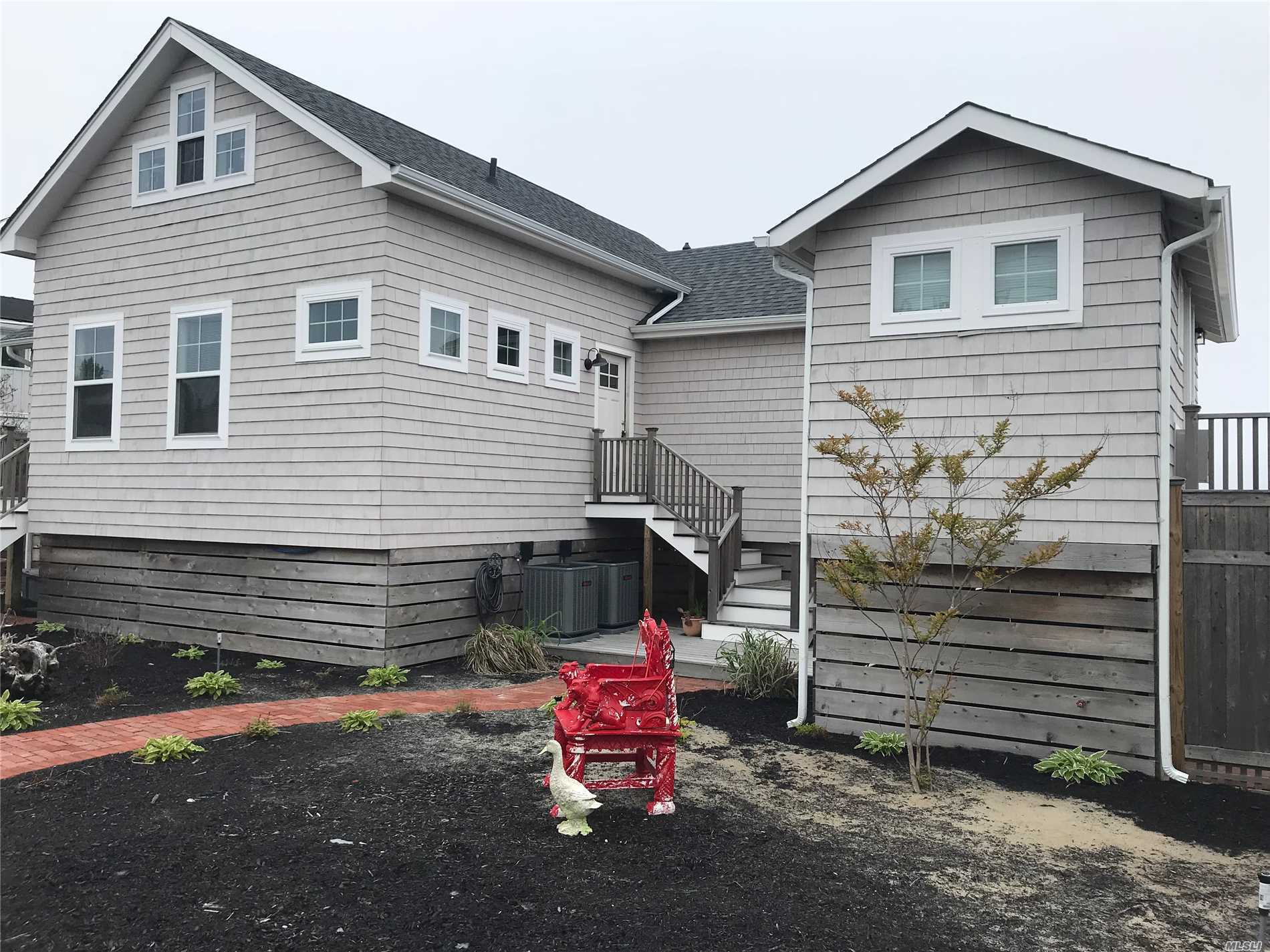 Photo of home for sale at 114 Bay View Walk, Cherry Grove NY