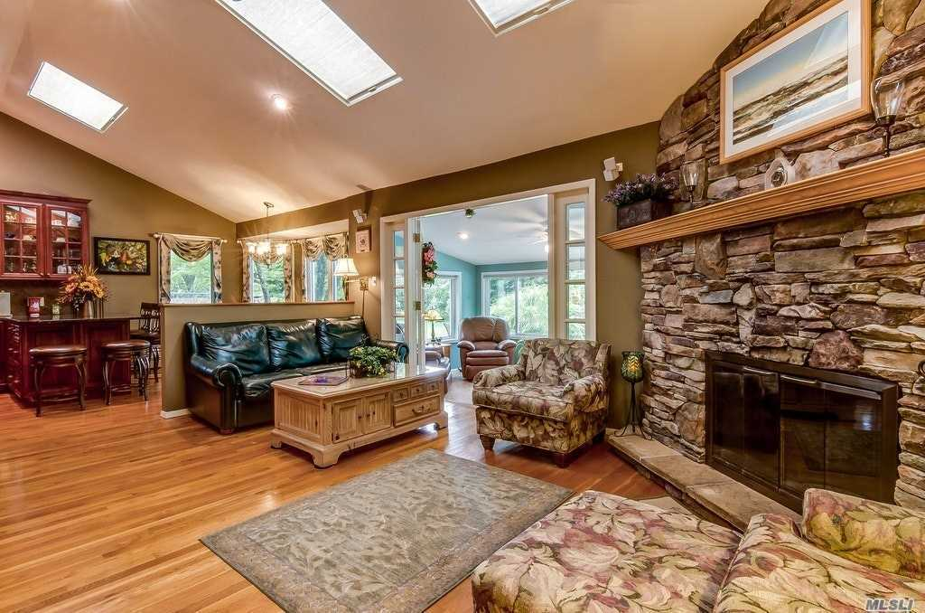 Photo of home for sale at 65 Quail Run, East Islip NY