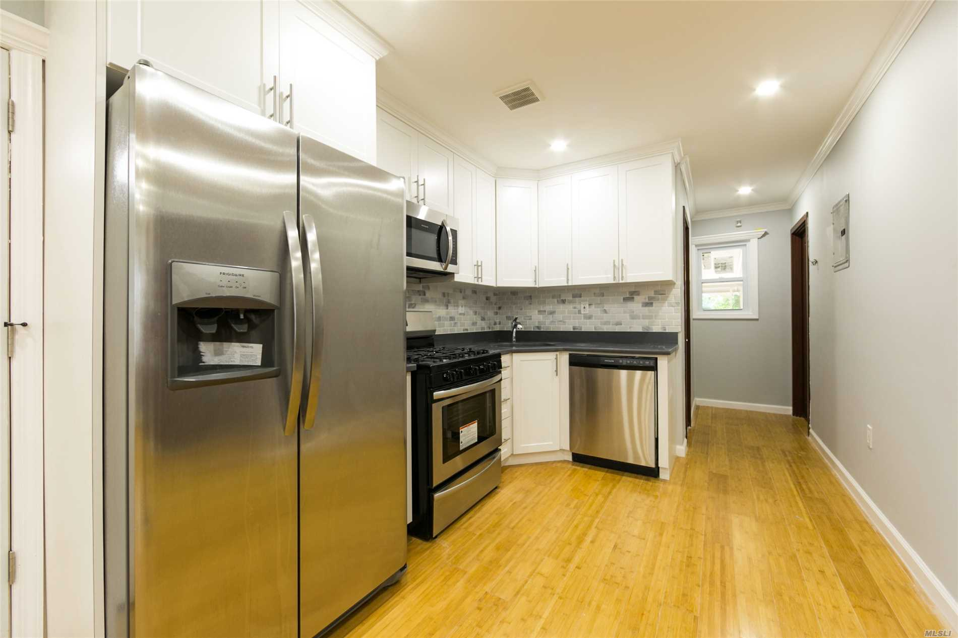 Photo of home for sale at 86-09 102nd Ave, Ozone Park NY