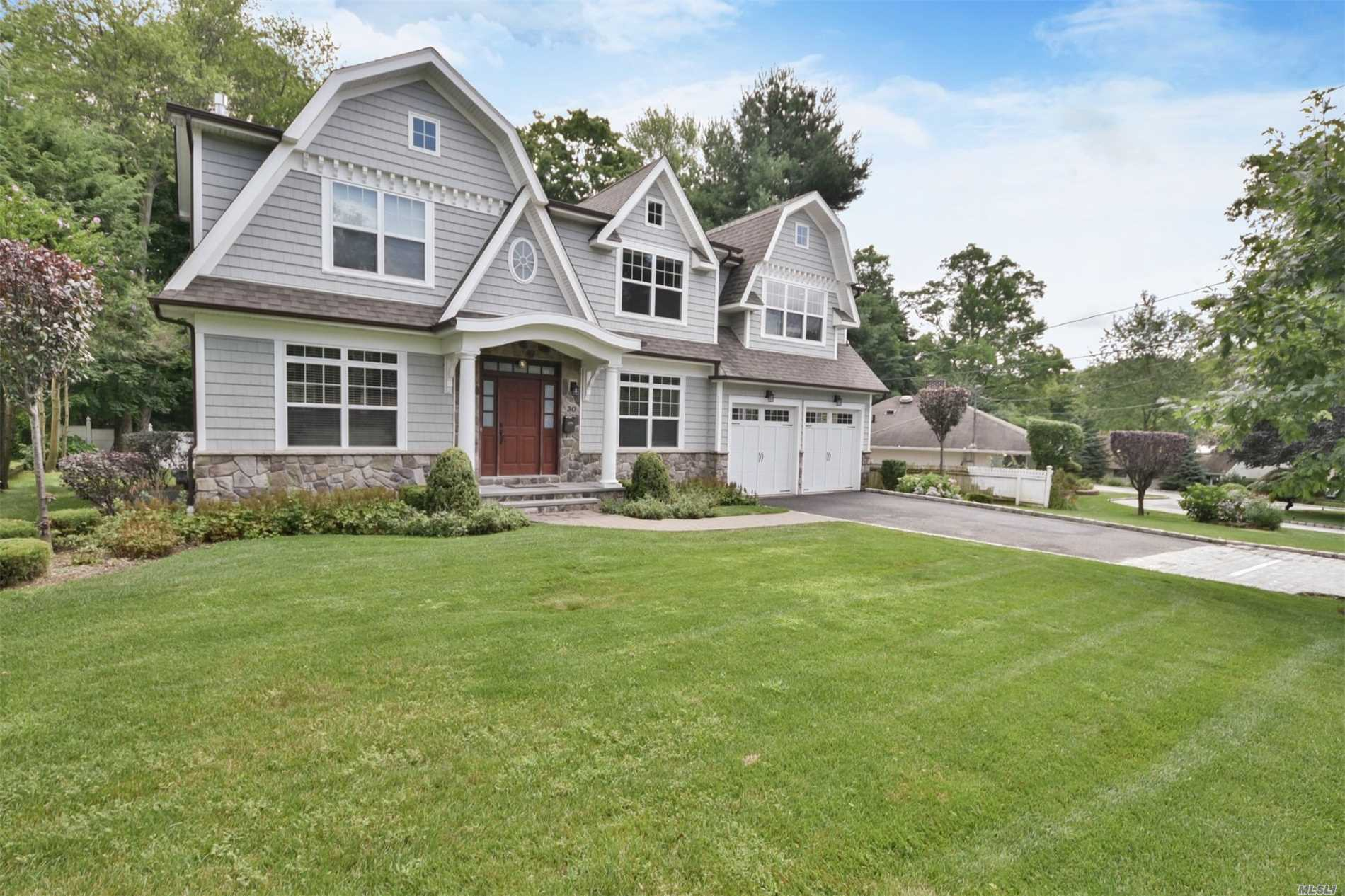 Photo of home for sale at 30 Ridge Drive East, Roslyn NY