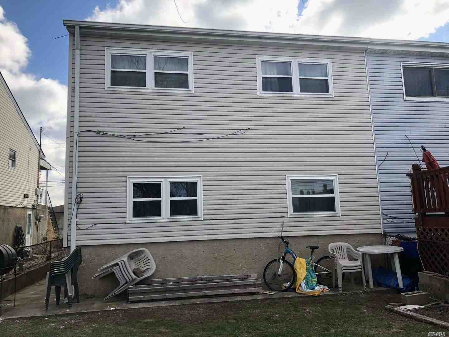 Photo of home for sale at 611 Beach 68th St, Far Rockaway NY