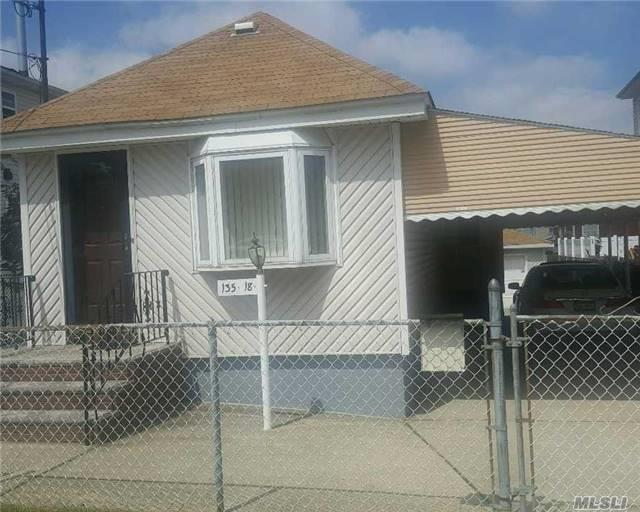 Photo of home for sale at 135-18 125th St, South Ozone Park NY