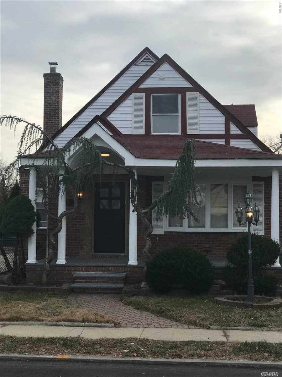 Photo of home for sale at 115-53 231 St, Cambria Heights NY