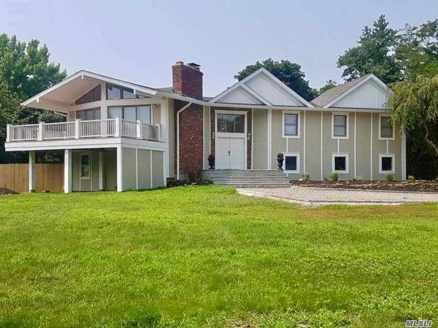 Photo of home for sale at 8 Mooring Dr, Bellport NY