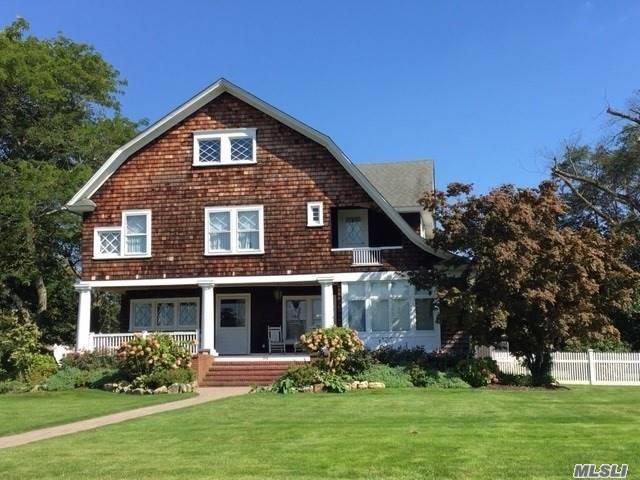 Photo of home for sale at 64 Riverside Ave, Amityville NY