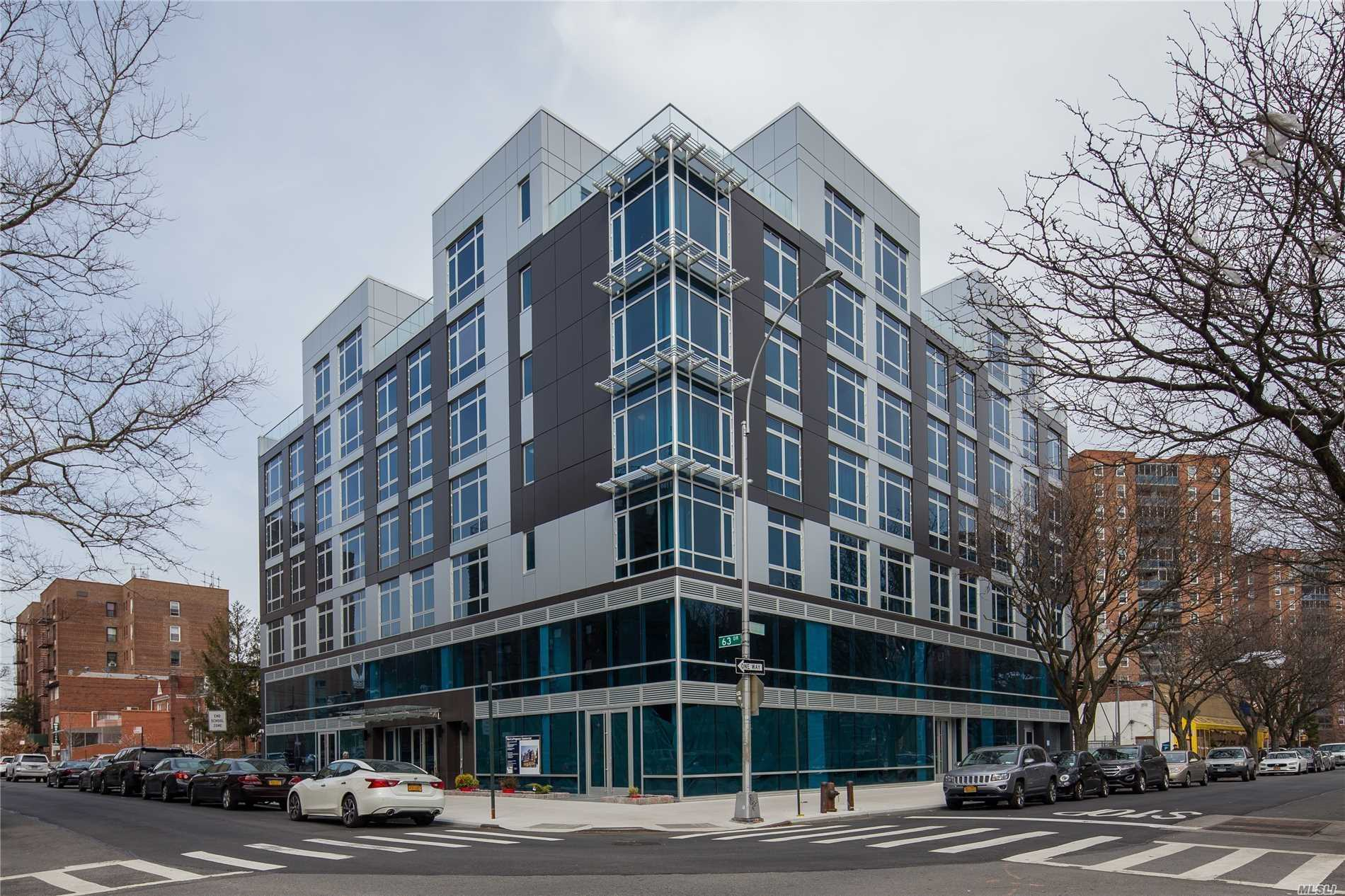Photo of home for sale at 97-45 63 Dr, Rego Park NY