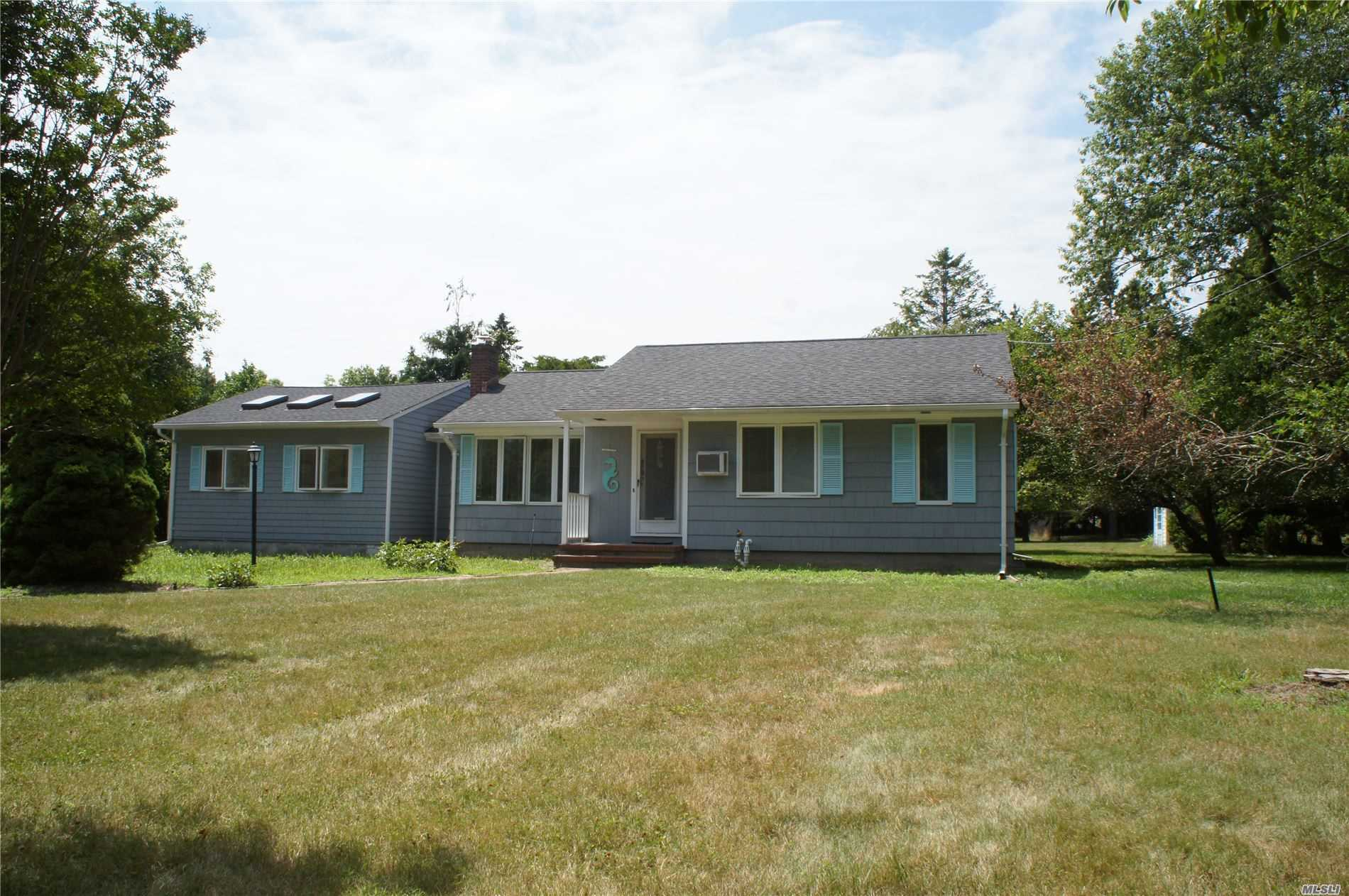 Photo of home for sale at 18 Tuthill Point Rd, East Moriches NY