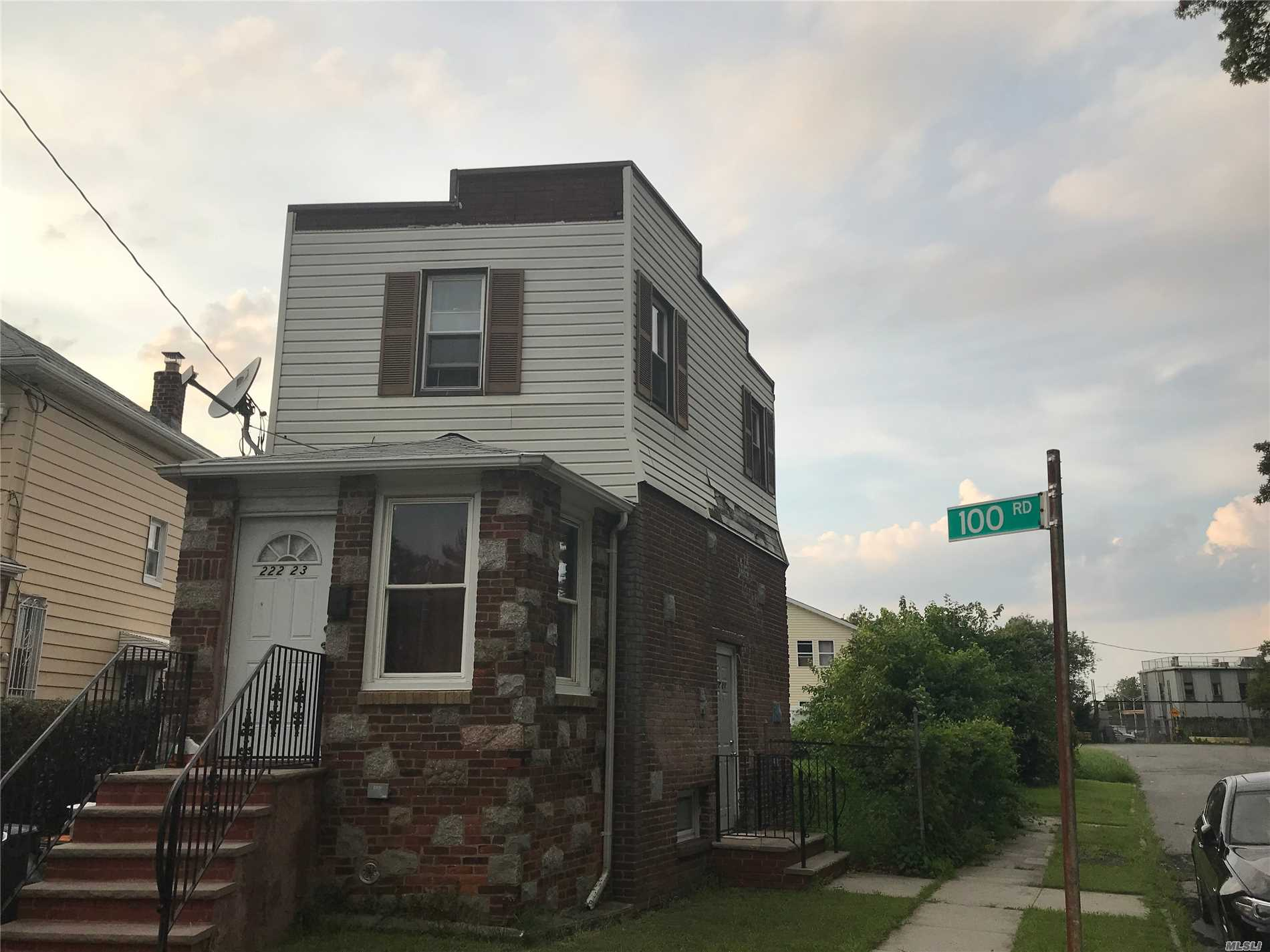 Photo of home for sale at 222-23 100th Rd, Queens Village NY