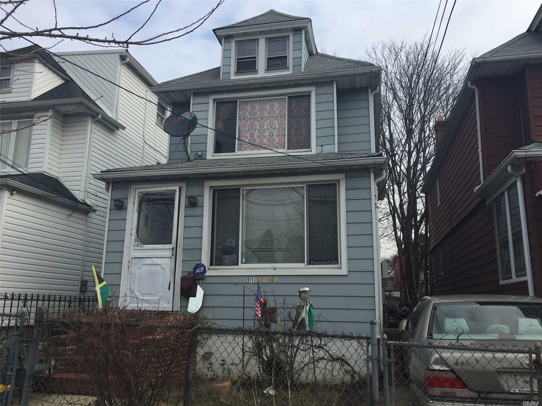 Photo of home for sale at 111-43 130th St, South Ozone Park NY