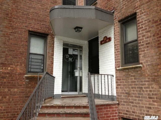 Photo of home for sale at 113-15 34 Ave, Corona NY