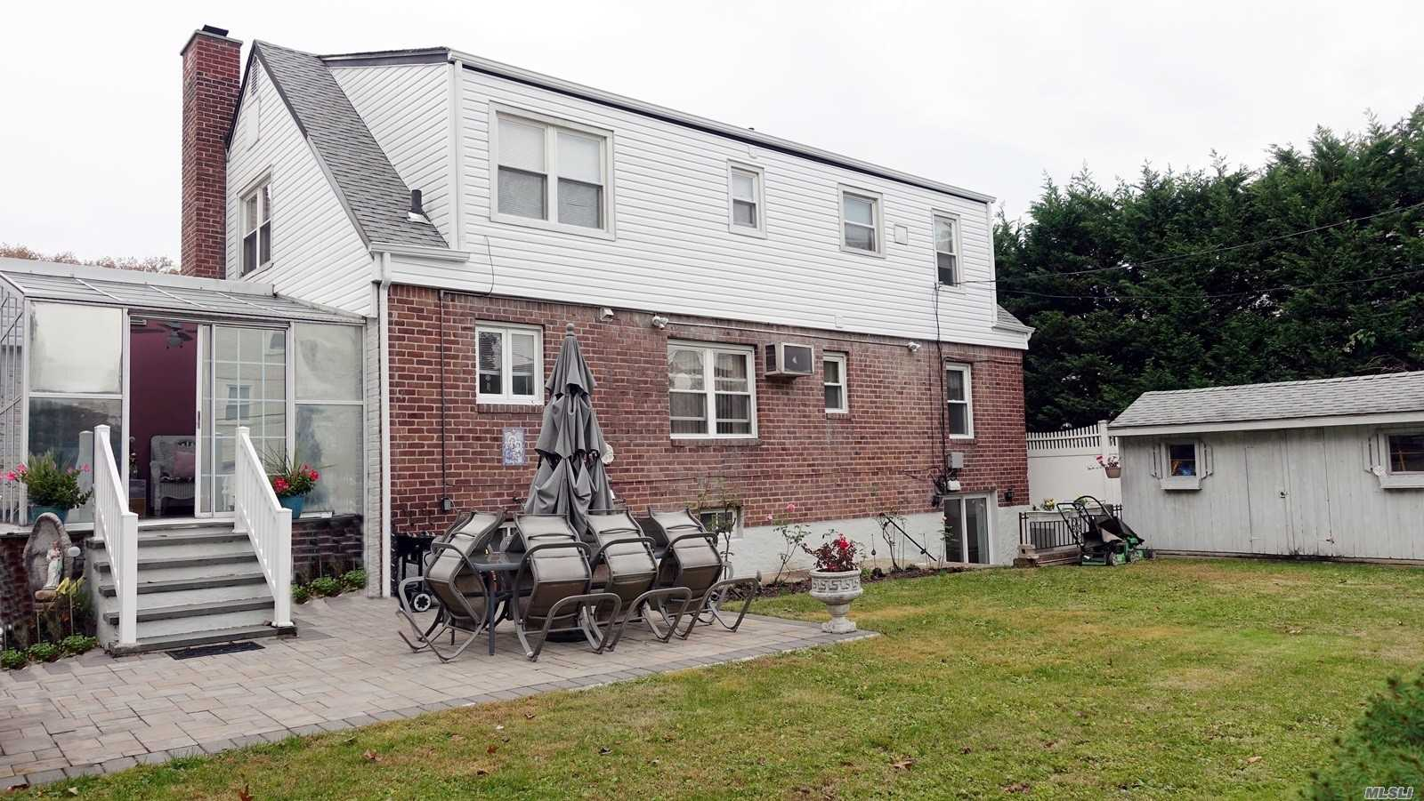 Photo of home for sale at 209-48 34 Ave, Bayside NY