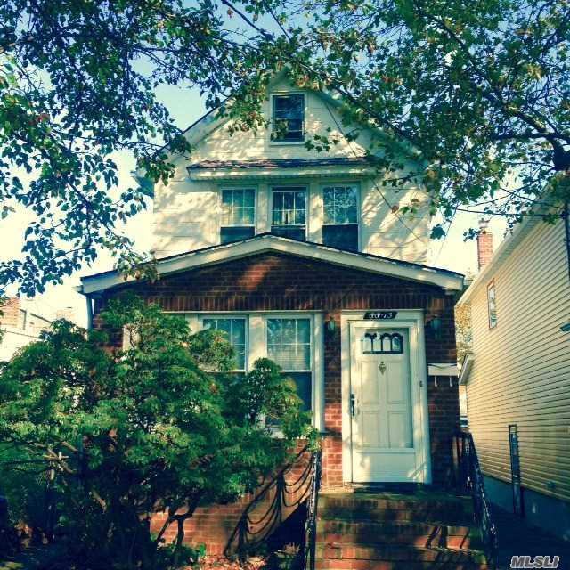 Photo of home for sale at 88-15 Vanderveer St, Queens Village NY