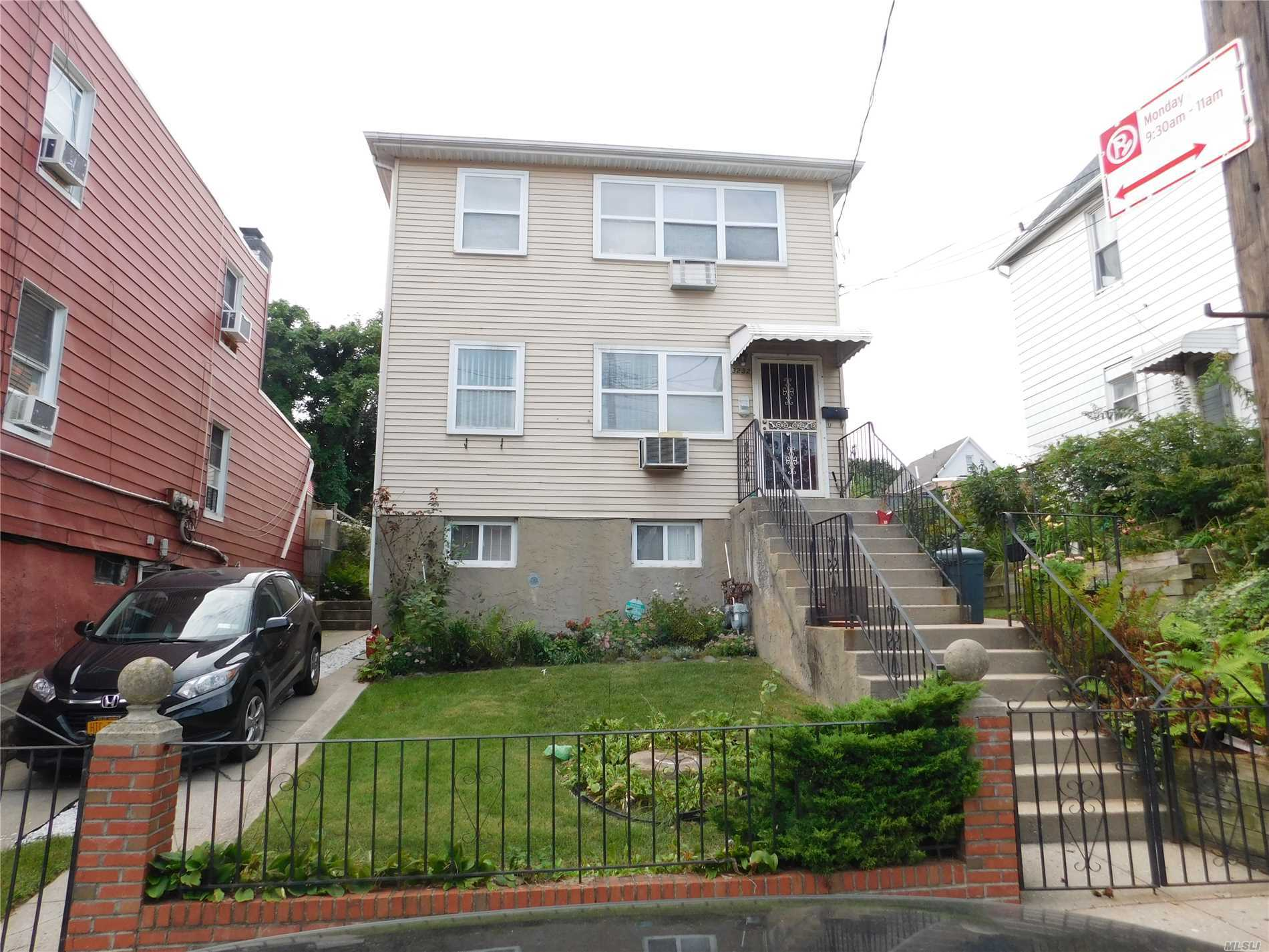 Photo of home for sale at 32-32 103rd Street, East Elmhurst NY
