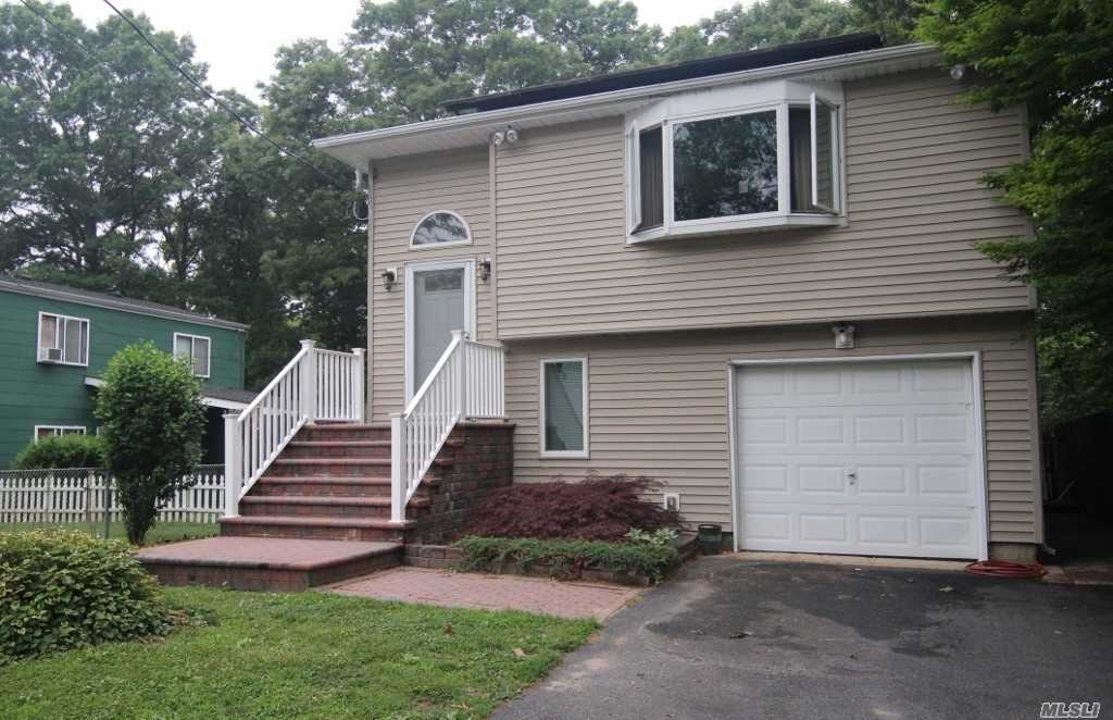 Photo of home for sale at 56 Abbott Ave, Mastic NY