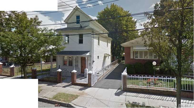 Photo of home for sale at 163-62 Mathias Ave, Jamaica NY