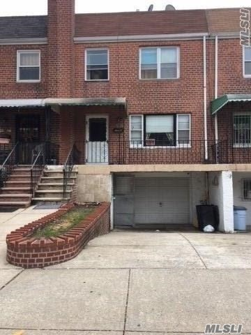 Photo of home for sale at 25-56 76th St, East Elmhurst NY