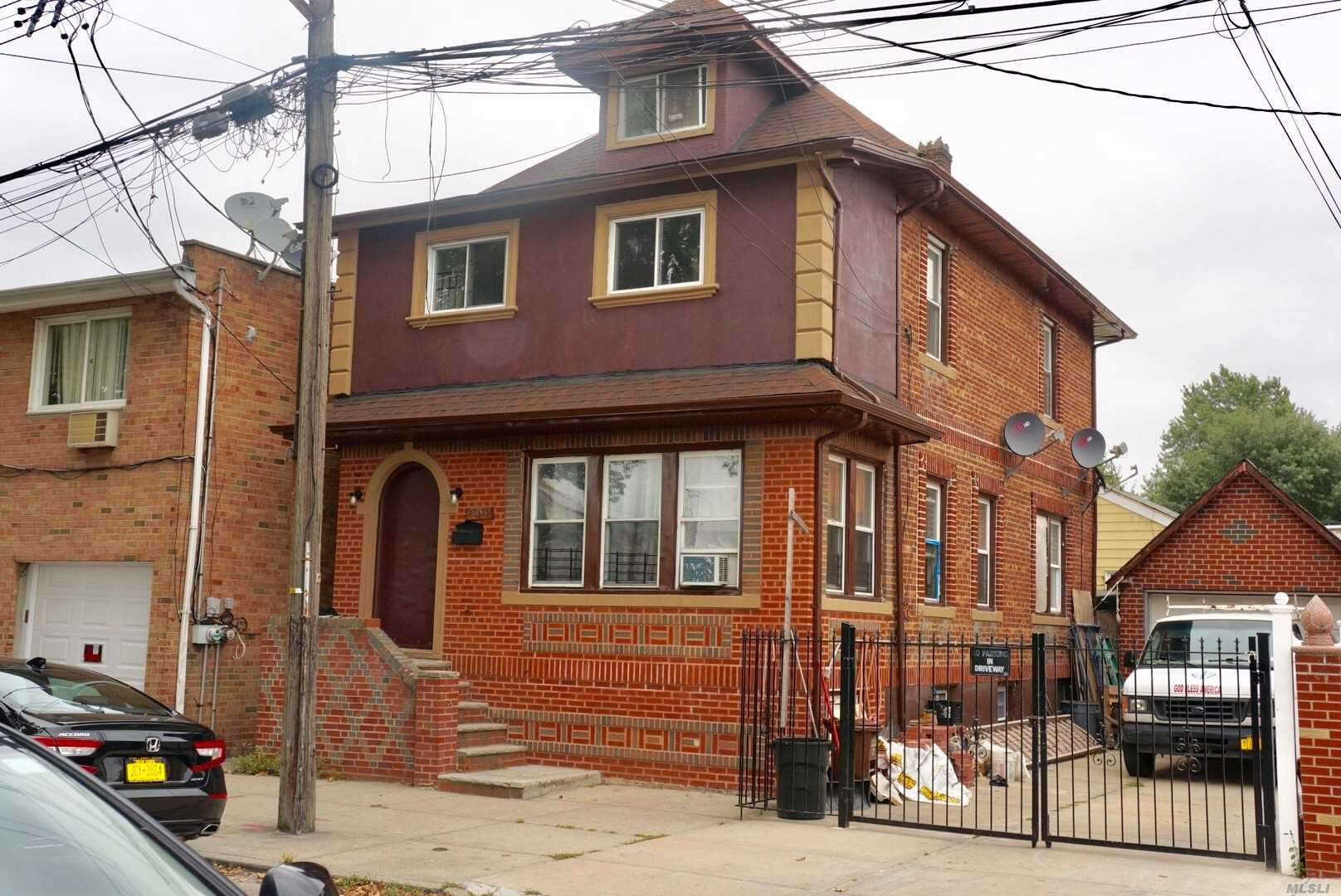 Photo of home for sale at 135-15 127th St, South Ozone Park NY