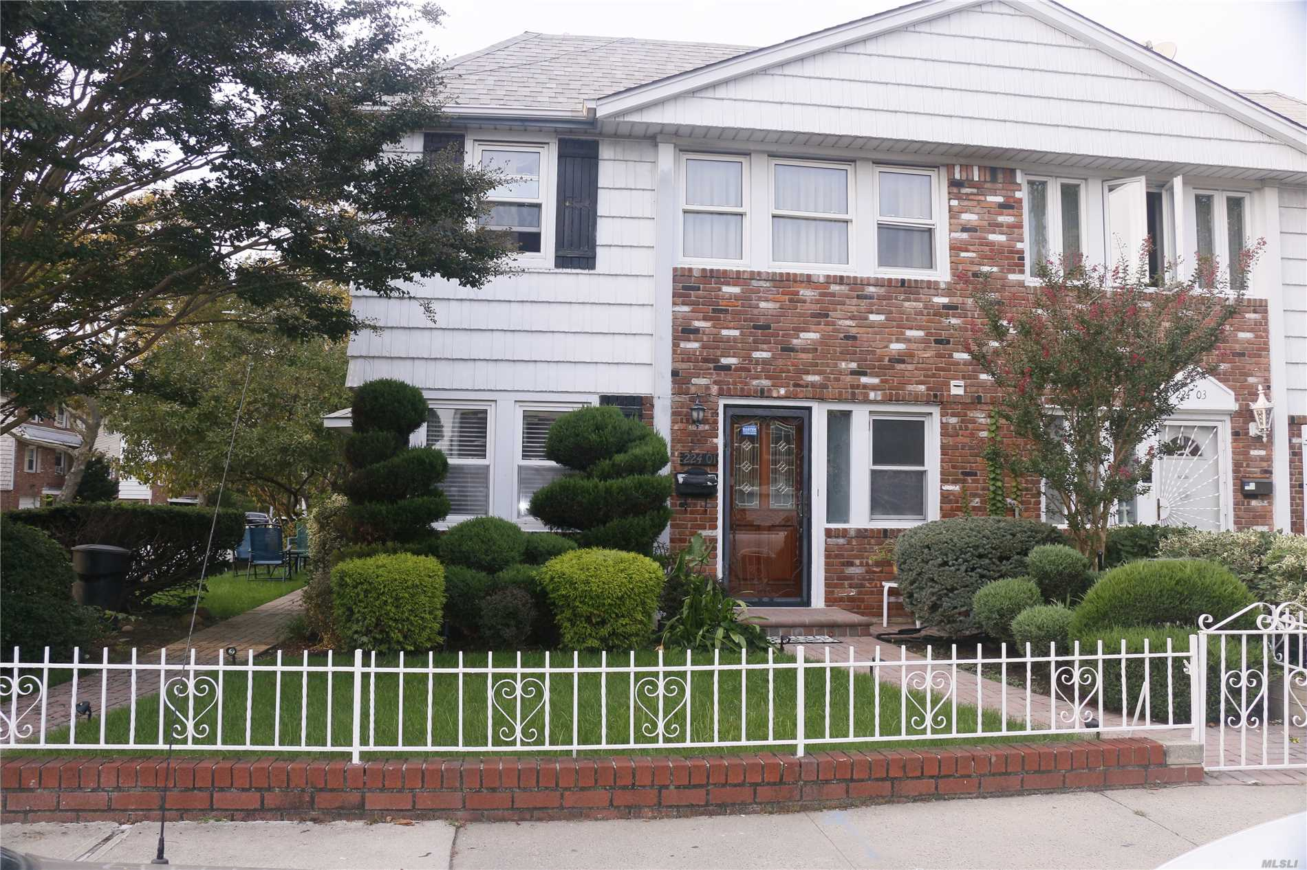 Photo of home for sale at 224-01 59th Ave, Bayside NY
