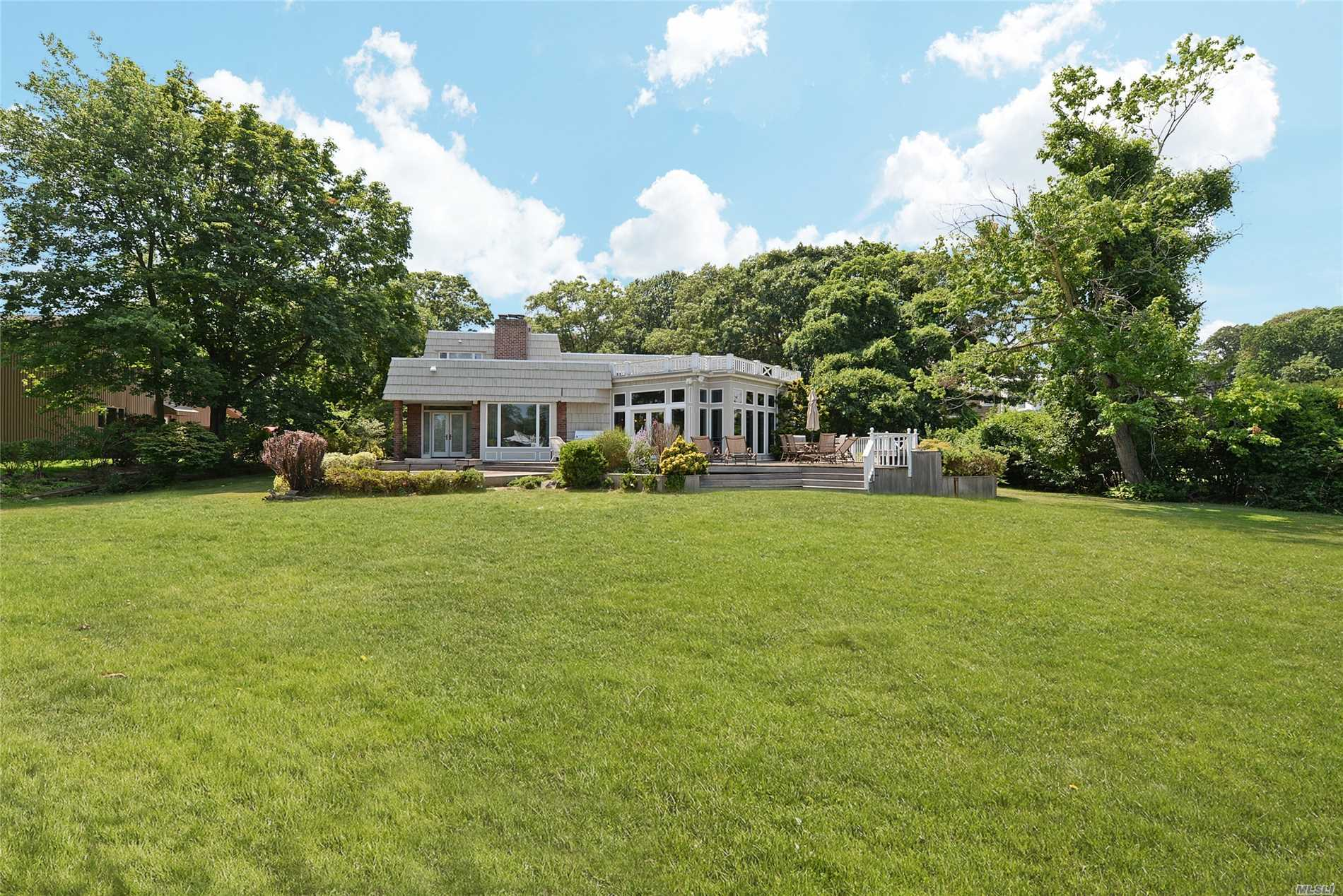 Photo of home for sale at 90 Anchorage Rd, Hewlett Bay Park NY