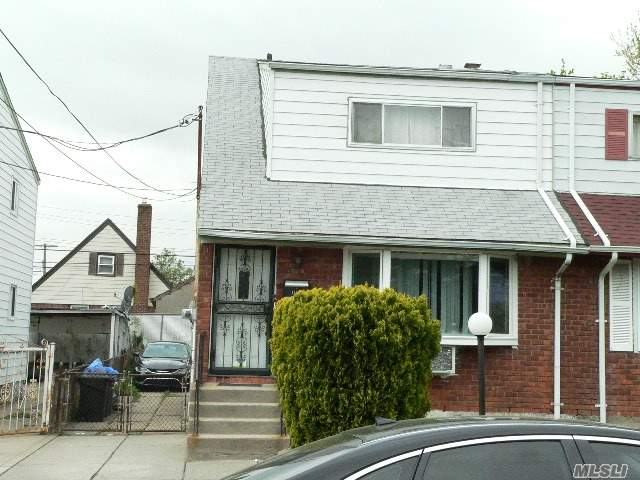 Photo of home for sale at 130-18 144th St, Jamaica South NY