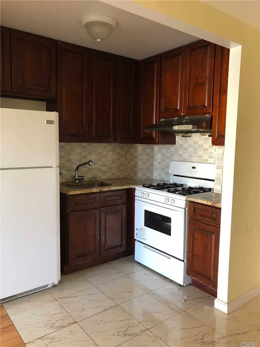 Photo of home for sale at 136-21 Latimer Pl, Flushing NY
